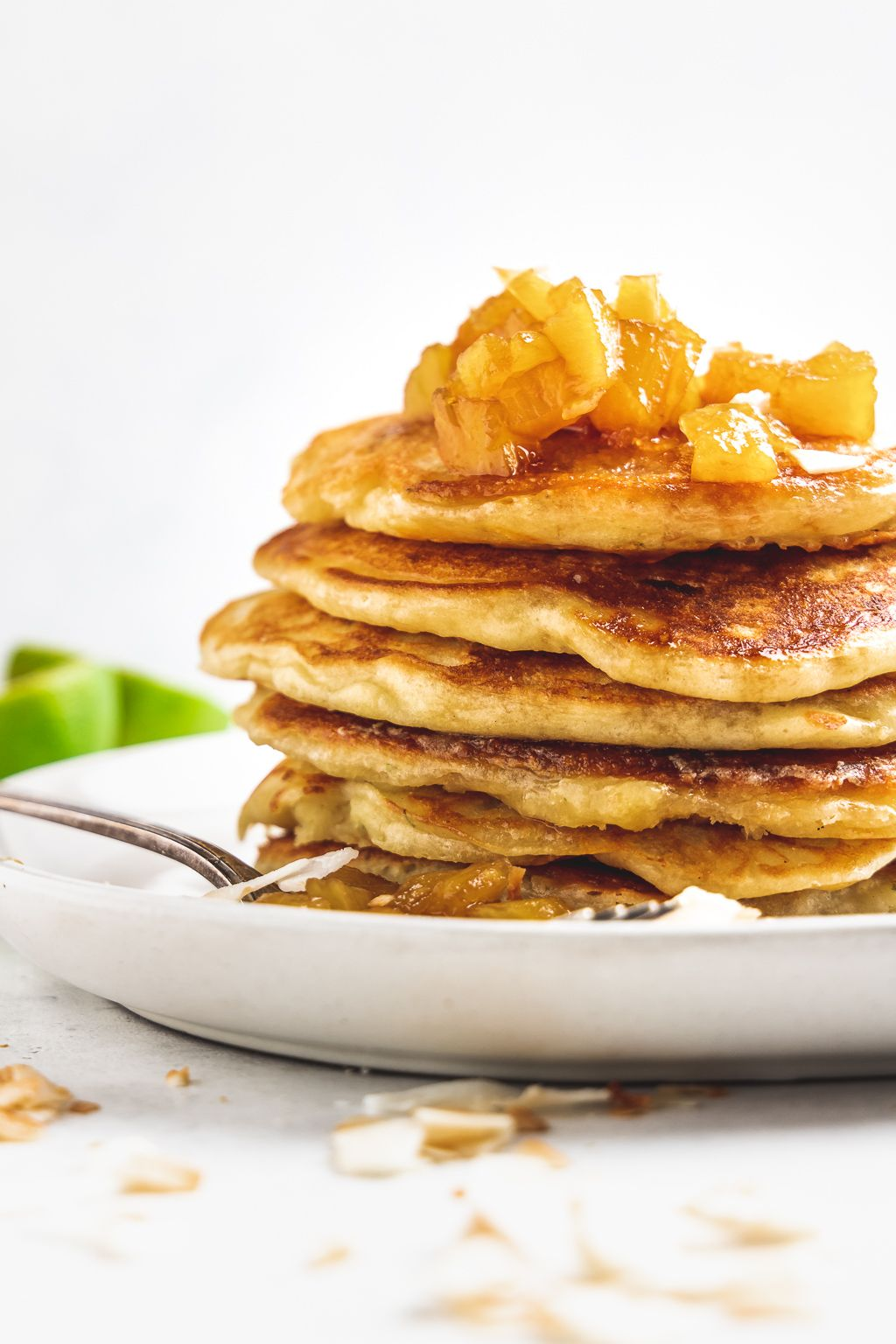 Stacked Pina Colada Pancakes with Chunky Pineapple Syrup