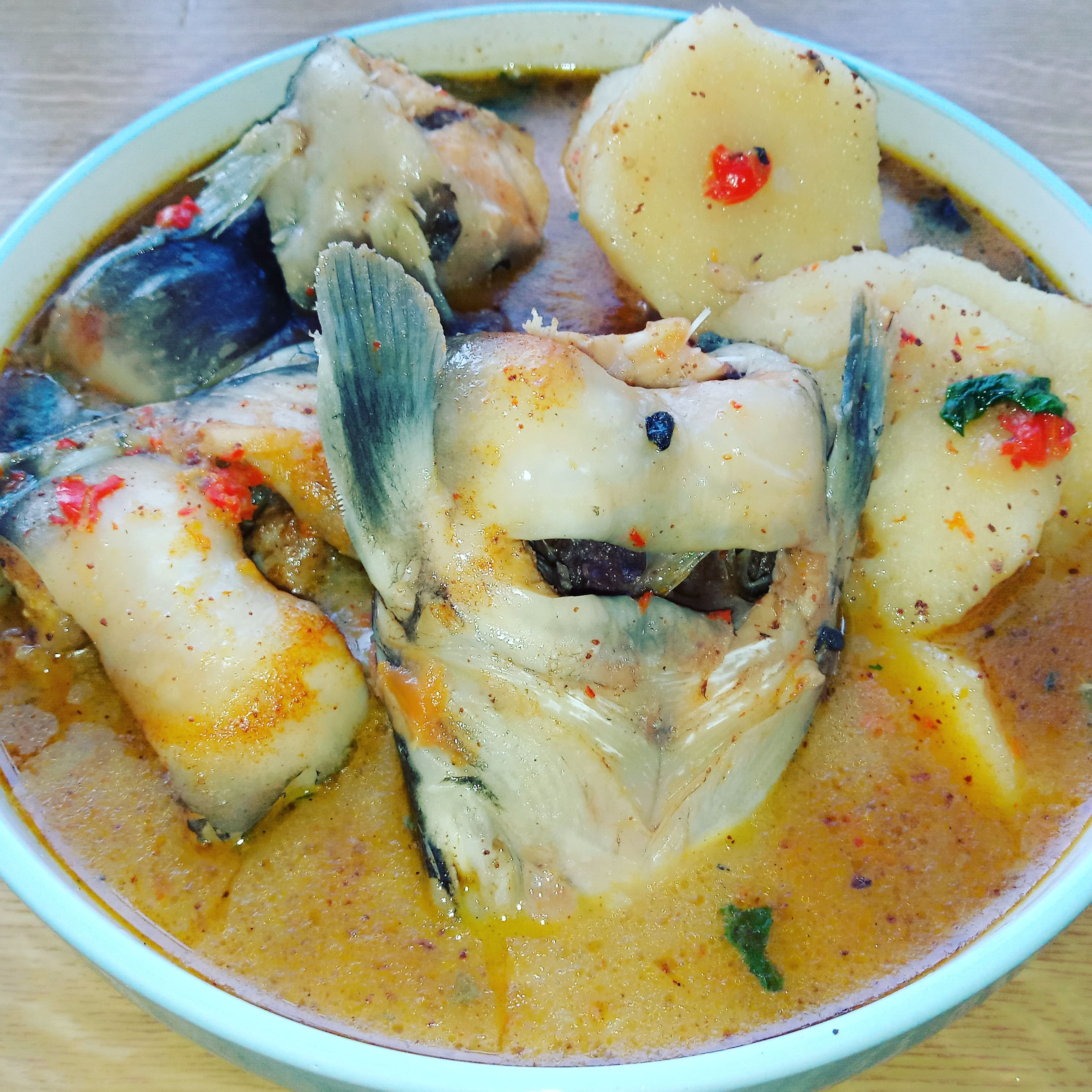 Spicy Fish soup with steamed yam and basil